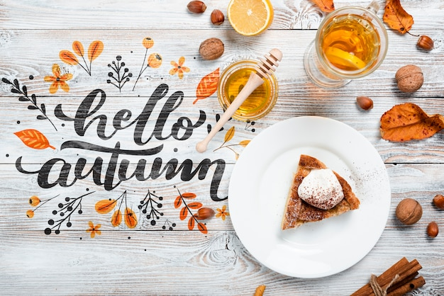 Top view fall season arrangement on wooden background Free Psd