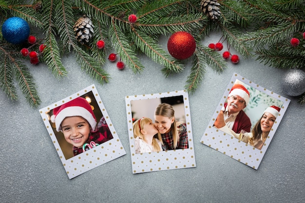Top view family photos with pine leaves Free Psd