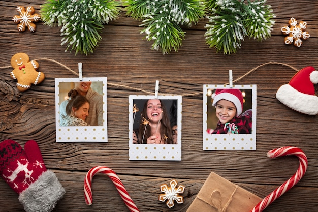 Top view family photos on wooden background Free Psd