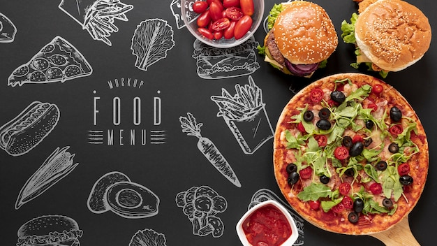 Top view of fast food on black background mock-up Free Psd