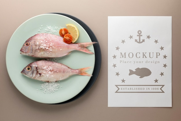 Top view of fish on plate with salt and tomatoes Free Psd