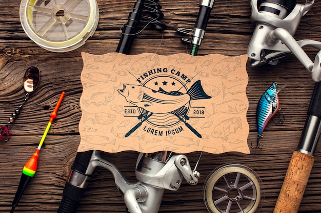 Top view fishing accessories surrounding the mock-up paper Free Psd