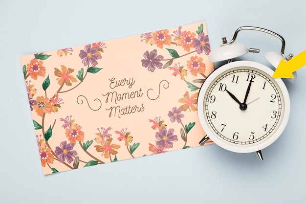 Top view of floral card with clock Free Psd