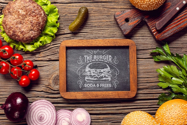 Top view frame burger ingredients wooden background Free Psd