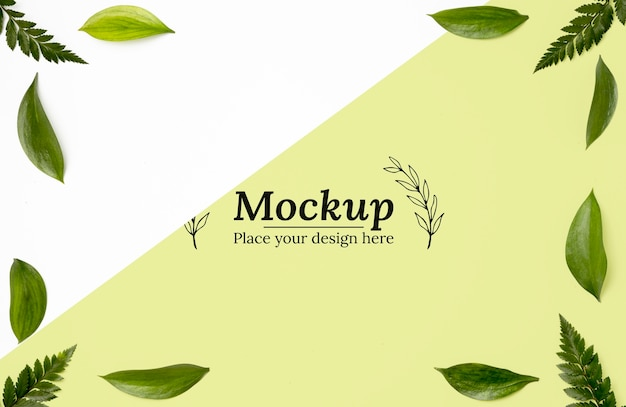 Top view of frame mock-up with leaves Free Psd