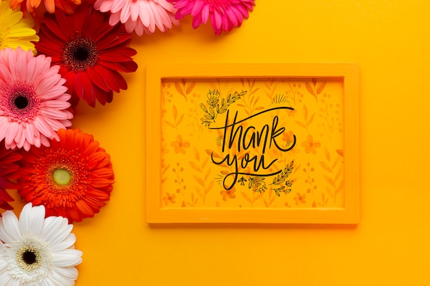 Top view of frame mock-up on yellow background Free Psd