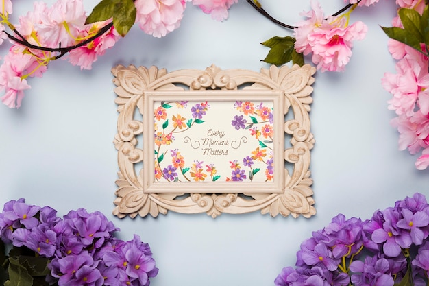 Top view of frame with spring flowers Free Psd