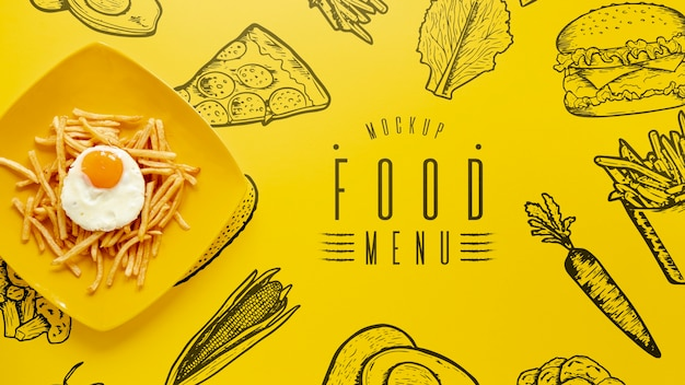 Top view of french fries and egg plate mock-up Free Psd