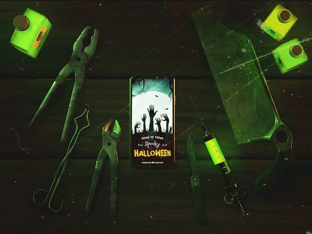 Top view halloween concept with smartphone Free Psd