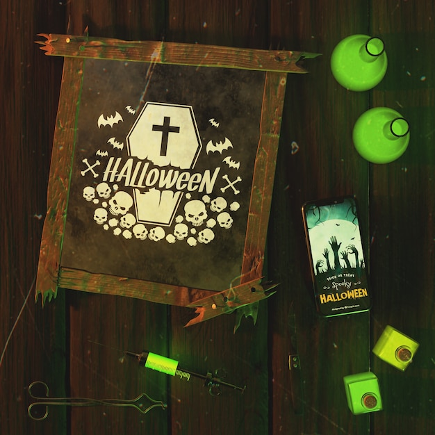 Top view halloween frame with smartphone Free Psd