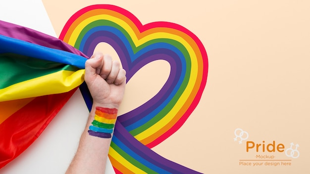 Top view of hand with rainbow for pride Free Psd