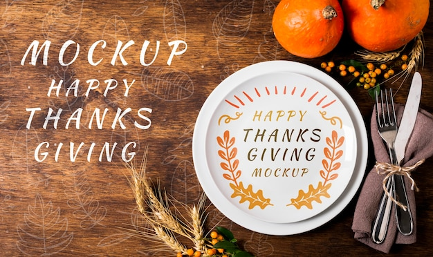 Top view happy thanksgiving with plate and cutlery mock-up Premium Psd
