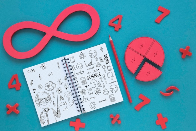 Top view of infinity with notebook and pencil Free Psd