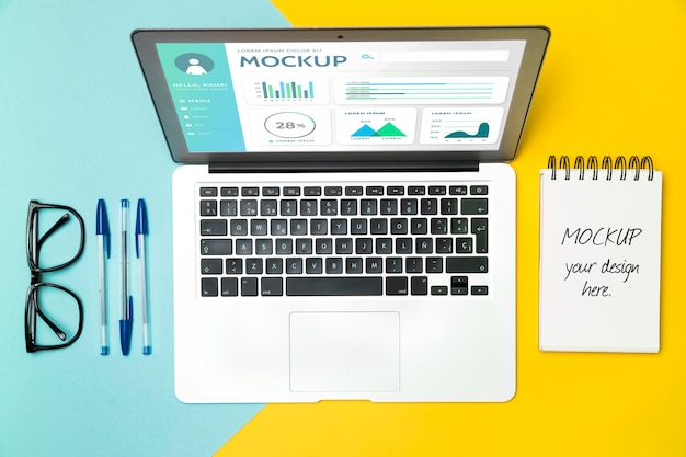 Top view laptop and desk items Free Psd