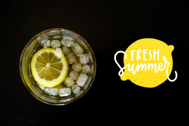 Top view lemonade full of ice cubes Free Psd