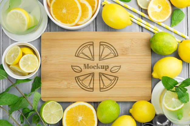 Top view lemons and mock-up cutting board Free Psd