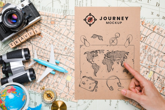 Top view of map mock-up traveling essentials Free Psd