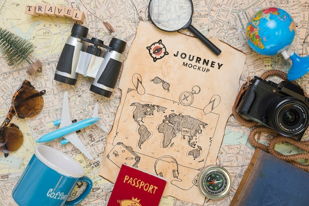 Top view of map with magnifying glass and camera for traveling Free Psd