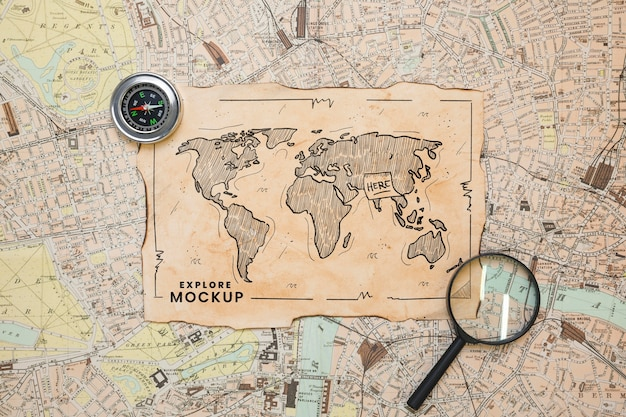 Top view of map with magnifying glass and compass for traveling Premium Psd