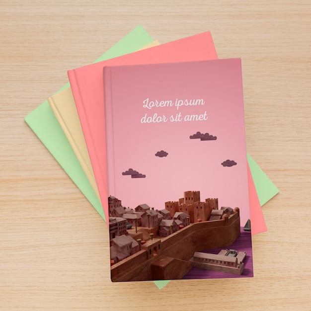 I libri minimalisti vista dall'alto coprono la composizione del modello Psd Gratuite