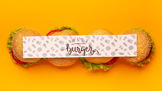 Top view mock-up banner and pile of burgers Free Psd