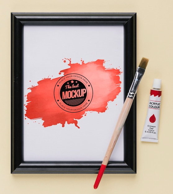 Top view of mock-up frame with paint brush and tube Free Psd