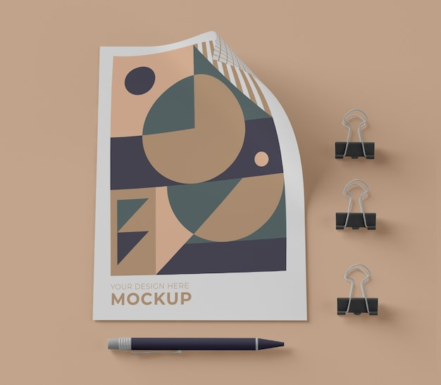 Top view of mock-up paper with pen and clips Free Psd