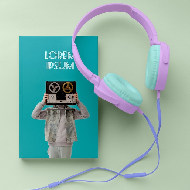 Top view music book cover mock-up arrangement with headphones Free Psd