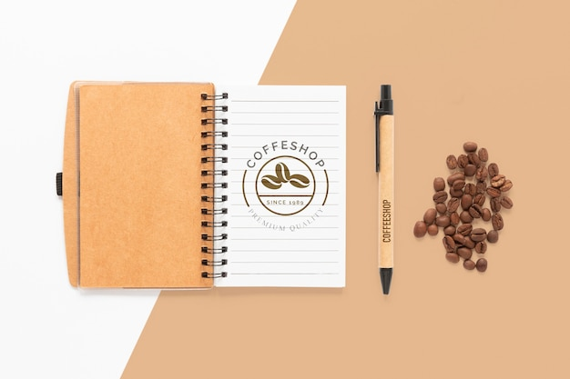 Top view notebook and coffee beans Free Psd