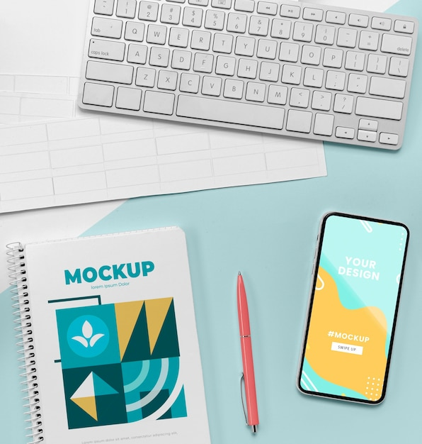 Top view notebook next to mobile Premium Psd