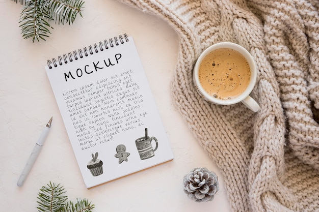 Top view of notebook with coffee and sweater Premium Psd