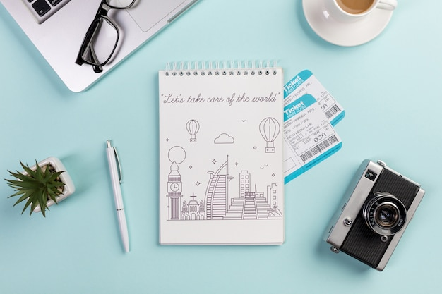 Top view notebook with flight tickets and camera Free Psd