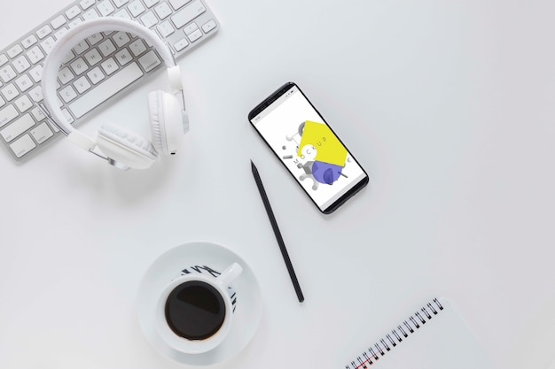 Top view office desk with mobile phone and coffee Free Psd