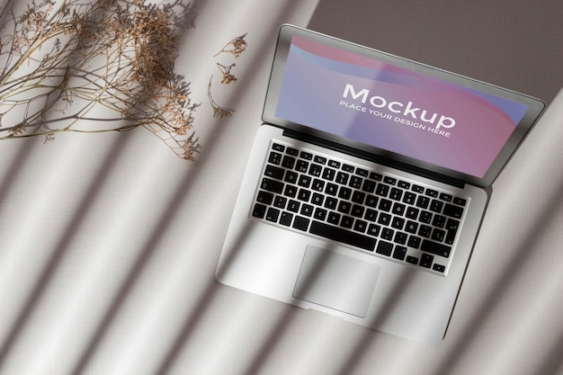 Top view opened laptop with screen mockup with shadows Free Psd