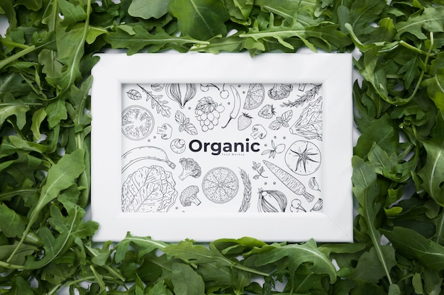 Top view organic frame surrounded by rocket Free Psd