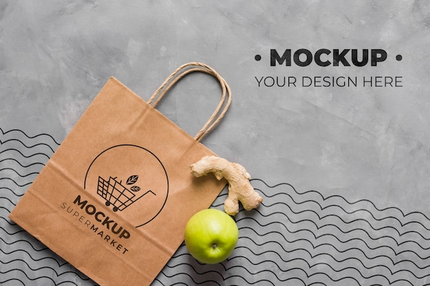 Top view paper bag mock-up with apple and ginger Free Psd