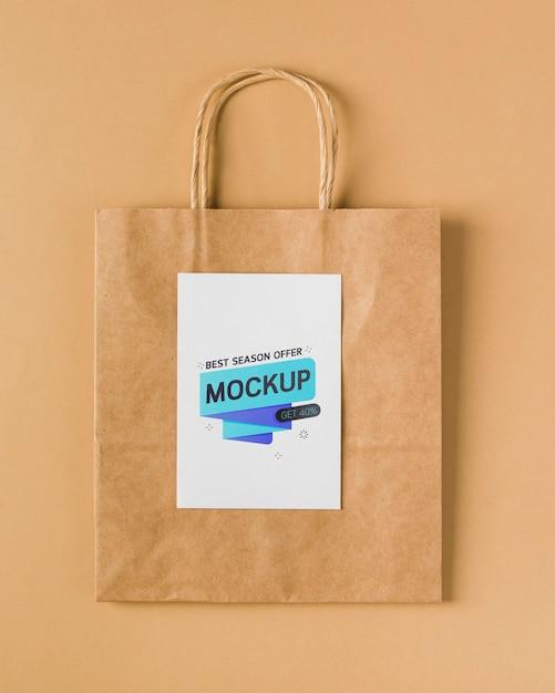 Mock-up di sacchetto di carta vista dall'alto con manici Psd Gratuite