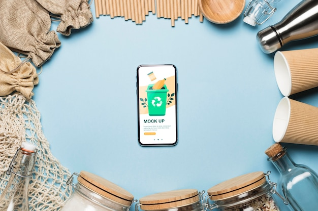 Top view of paper cups and zero waste items with smartphone Free Psd