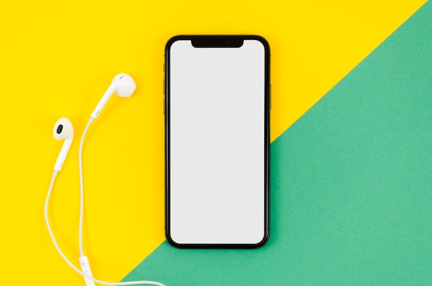 Top view phone mock-up with earphones Free Psd