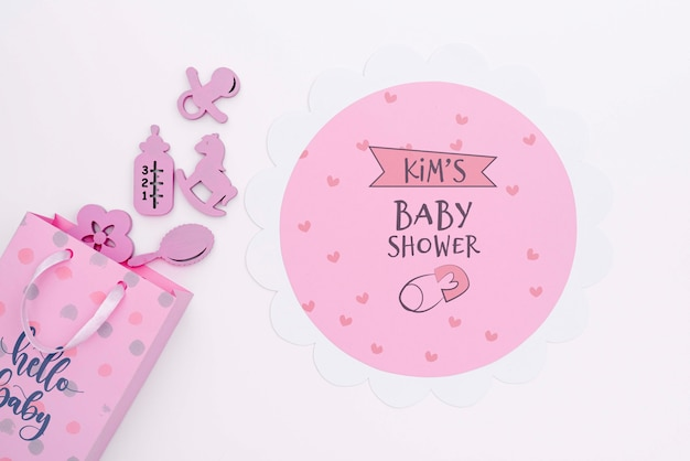 Top view of pink baby shower decor with gift bag Free Psd