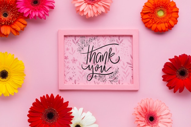 Top view of pink frame mock-up with flowers Free Psd
