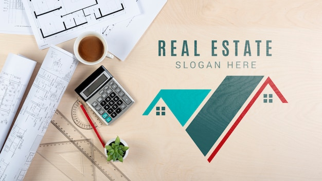Top view real estate design with stationery items Premium Psd
