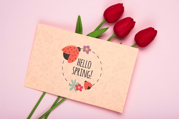 Top view of red tulips and card Free Psd