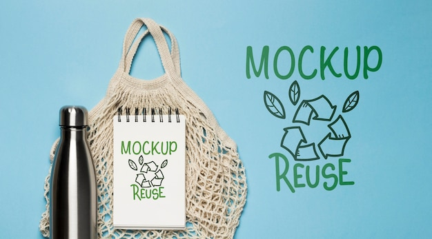 Top view of reusable bag with bottle Free Psd