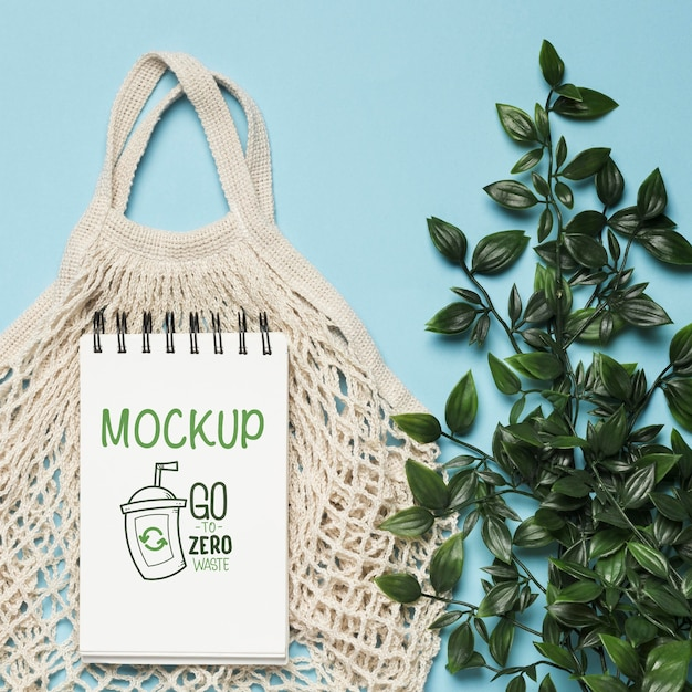 Top view of reusable bag with plant Premium Psd