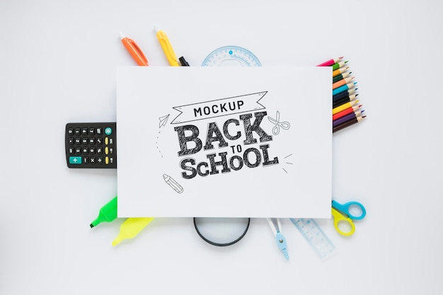 Top view school items on white background Free Psd