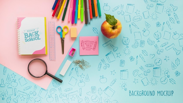 Top view school supplies on blue background Free Psd