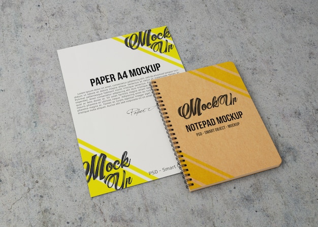 Top view of sheet of paper and notebook mockup Premium Psd