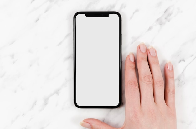 Top view smartphone mock-up with hand Free Psd