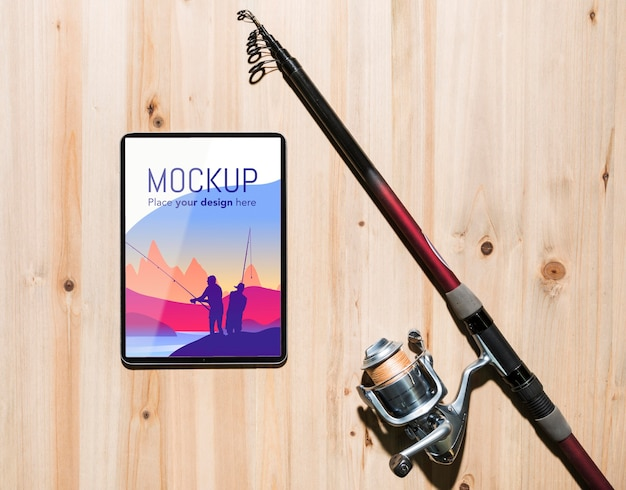 Top view of smartphone with fishing rod Free Psd